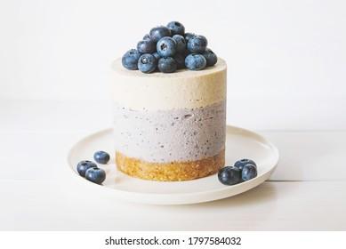 Raw gluten-free no-bake dessert. Vegan vanilla blueberry cheesecake against white background. Sweet healthy food. - Shutterstock ID 1797584032