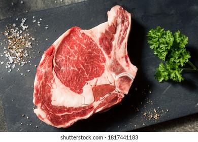 Raw Grass Fed Ribeye Steak with Salt and Pepper