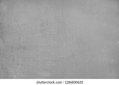 Raw gray plastered concrete beton wall as full frame background.