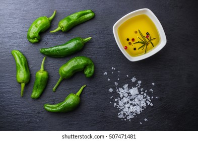 Raw green hot mexican peppers jalapeno pimientos padron spanish tapas