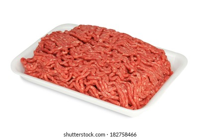 Raw ground beef in a white polystyrene tray isolated on a white background. Suitable for illustrating contaminated or recalled ground beef.