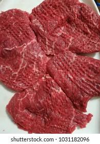 Raw hacked beef steaks
