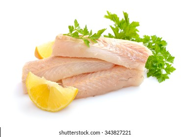 Raw Hake fish fillet pieces. Isolated on white background.