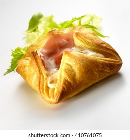 Raw ham puff pastry and fresh salad, isolated on a white background