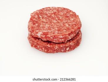 Raw hamburger over white background
