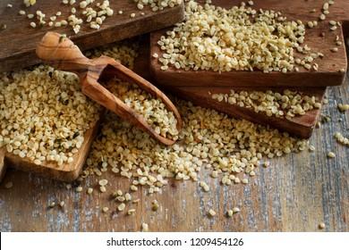 Raw Hemp seeds on a wooden background