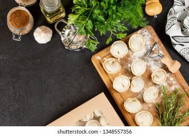 Raw homemade dumplings on wooden board
