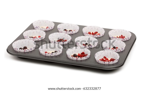 raw homemade Muffin before baking on plate isolated on white background