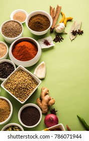 Raw Indian Spice Powder over green background, selective focus