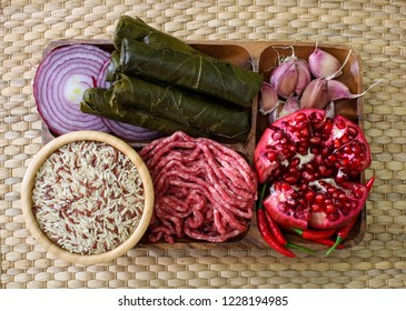 Raw ingredients for cooking dolma. Grape leaves, beef and pomegranate