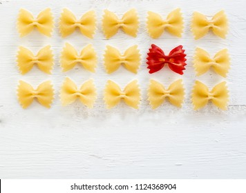 raw Italian pasta Farfalle - abstract vision be different, unique personality or standing out from the crowd, leadership quality. beautiful still life background