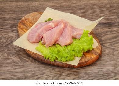 Raw juicy turkey breast steak for cooking