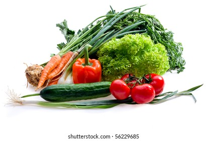 Raw juicy vegetables on white background