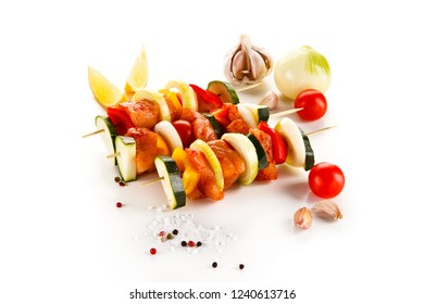 Raw kebabs on white background