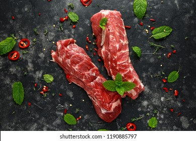 Raw lamb shoulder fillets with chilli, thyme and mint leaves