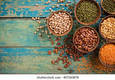 Raw legume on old rustic wooden table, close-up.
