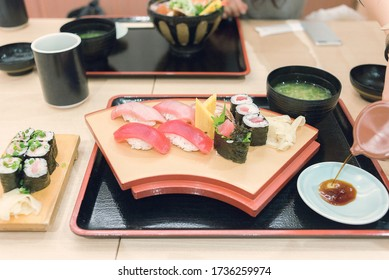 Raw maguro red tuna sushi and fatty tuna called chuutoro served with miso soup and marinated ginger in Tokyo.