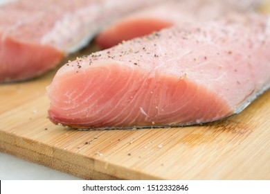 Raw Mahi Mahi (Dolphin Fish) Fillets on a Cutting Board