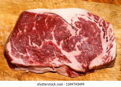 Raw marble beef steak on wooden  cutting board