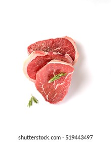 Raw  marbled beef on a  a white background