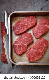 Raw marbled beef steak in a pan