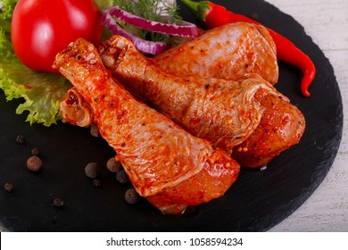 Raw marinated chicken legs for grill and bbq
