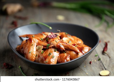 Raw Marinated chicken wings for BBQ, with green onion and dry red pepper
