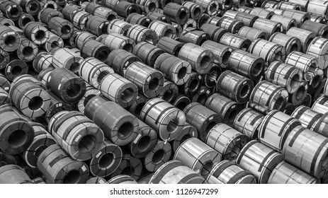 Raw material Handling: Steel coil storing inside a warehouse for exporting to automotive industry plant in black and white.