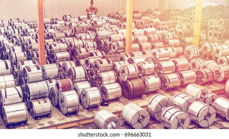Raw material Handling: Steel coil storing inside a warehouse for exporting to automotive industry plant.