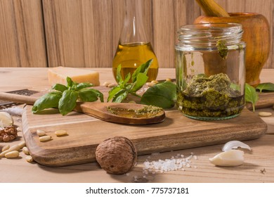 Raw materials for pesto sauce on rustic wooden table
