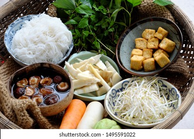 Raw materials Vietnamese vegetarian food,  bun mang or bamboo shoot noodles with tofu, mushroom, laksa leaves, herbs, an simple dish but delicious for vegan