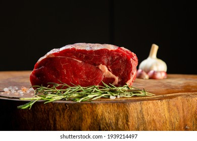 raw meat Angus Prime steaks machete, entrecot, garlic and spices on wooden table