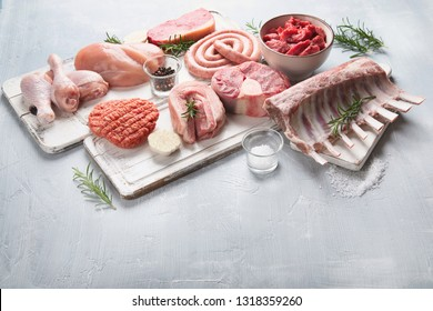 Raw meat - beef, pork, lamb, chicken with seasoning . Image with copy space