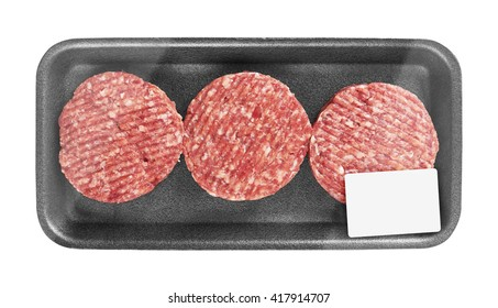 Raw meat patty in package, isolated on white