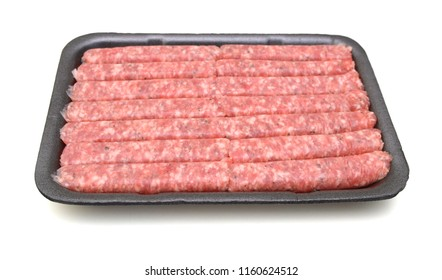 Raw meat sausages isolated in tray on white background