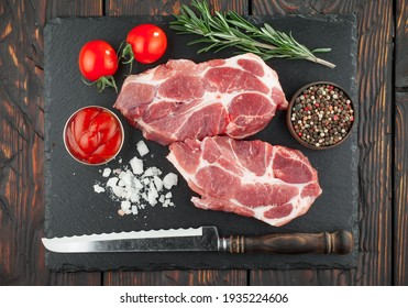 Raw meat with spices in a composition with kitchen accessories.