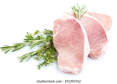 Raw meat steak with herbs isolated on white