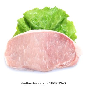 Raw meat steak with leaf lettuce, isolated on white