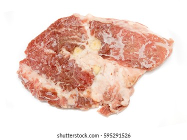 Raw meat steak on a white background