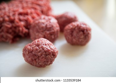 Raw meatballs mixed half beef, half pork minced meat for burger patty's