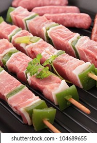 raw meats in grill pan