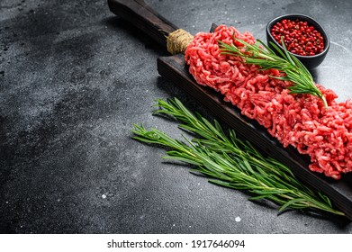 Raw Mince Ground meat with pepper. Black background. Top view. Copy space