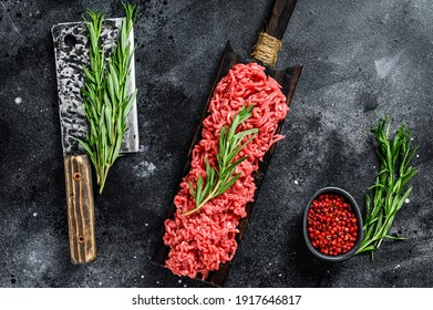 Raw Mince Ground meat with pepper. Black background. Top view