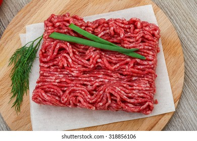 Raw minced beef meat with green oinion and dill