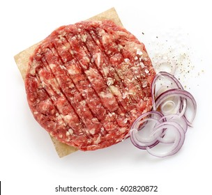 raw minced meat with onions, pepper and salt for making a burger isolated on white background, top view