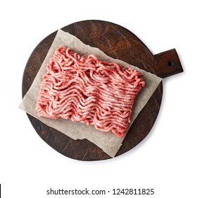 Raw minced pork meat on wooden board isolated on white background.