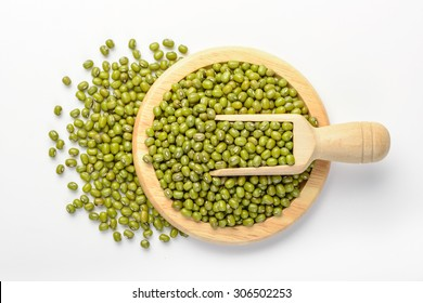 raw mung bean in the wooden plate, isolated on white, top view