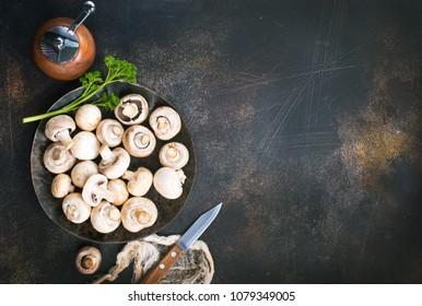 raw mushrooms, raw champignons, champignons on a table, stock photo