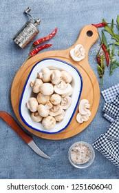 raw mushrooms on wooden board, Champignon mushrooms