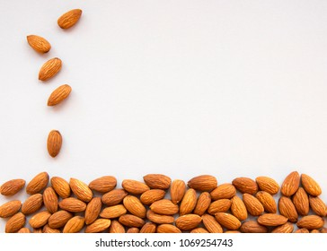 Raw Natural Organic Almonds Nuts Scattered Isolated on Grey Background Top View Healthy Food for Life Natural Light Selective Focus